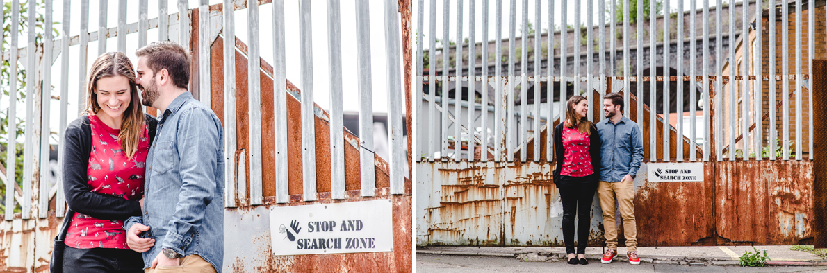 Engaged couple standing by a stop and search zone sign