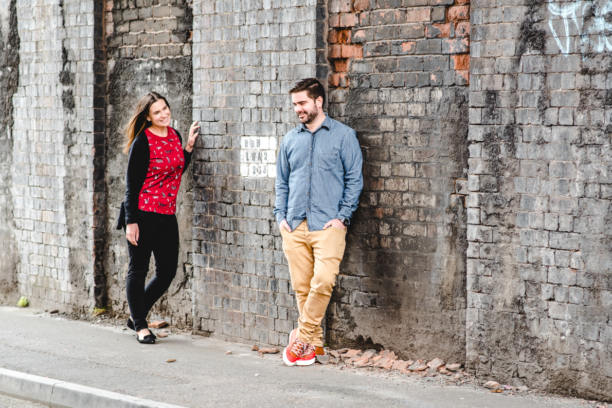 Couple standing against a wall at The Custard Factory in Birmingham