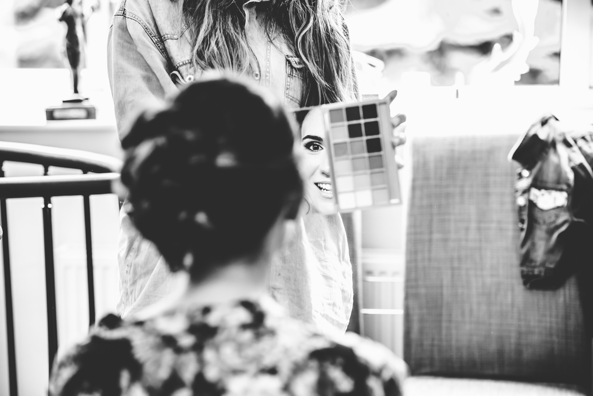 brides reflection in a mirror after having make-up done