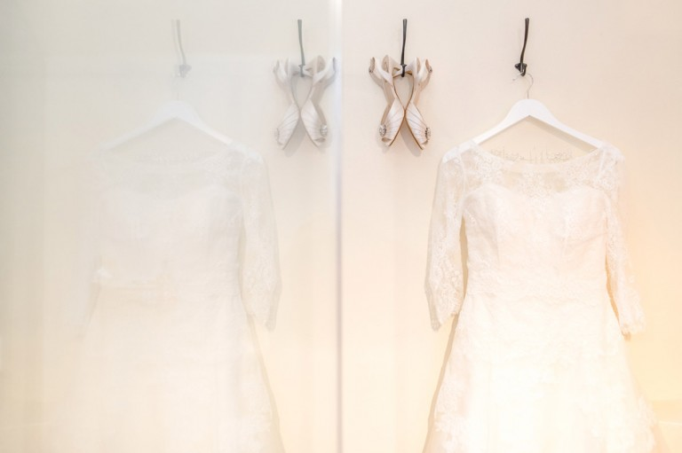 wedding dress and shoes hung up