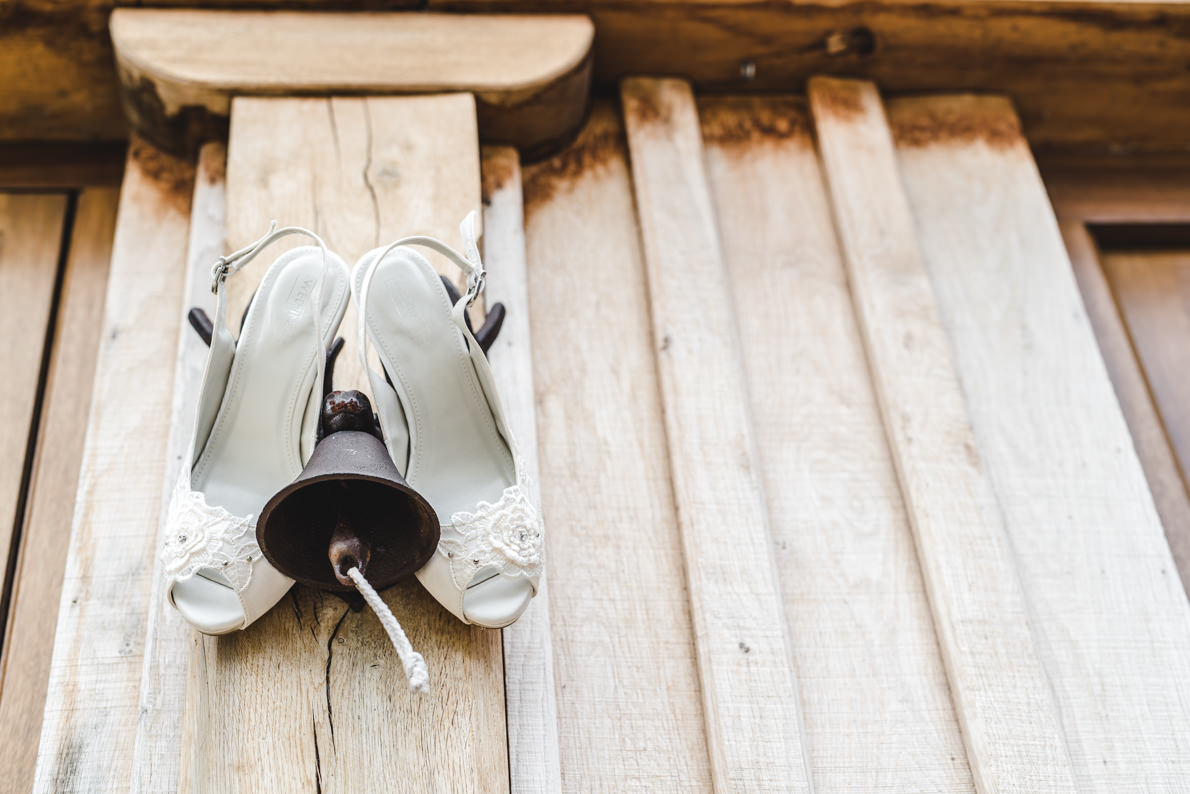 Brides shoes hanging on a lamp