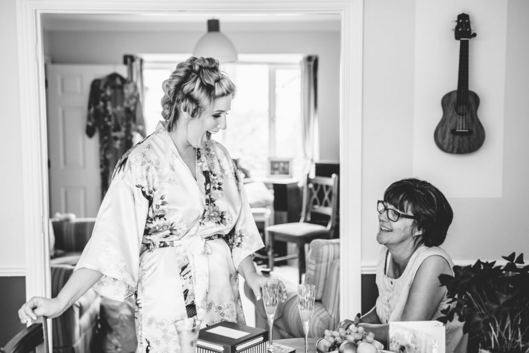 Black and white of a bride getting ready for her wedding in milton keynes