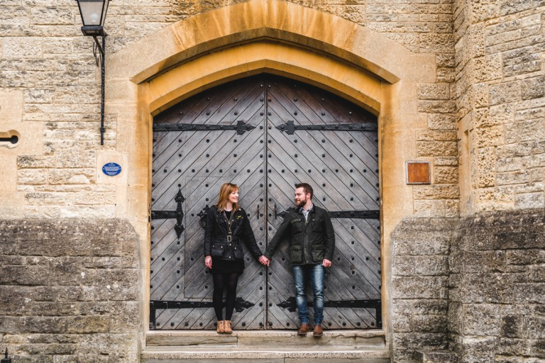 couple in front of large doors