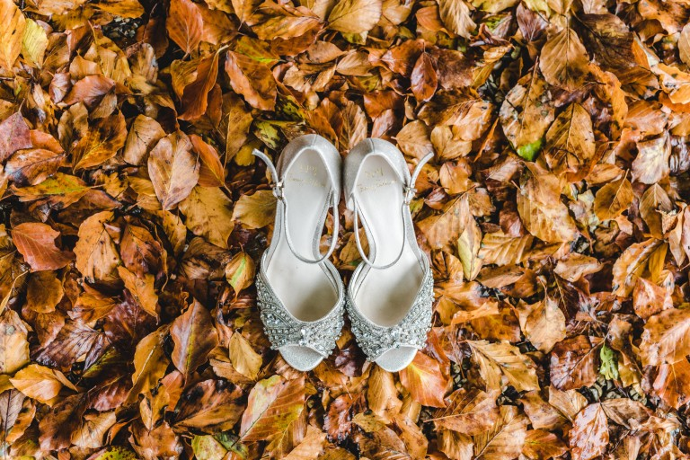 Wedding shoes amongst Autumn leaves