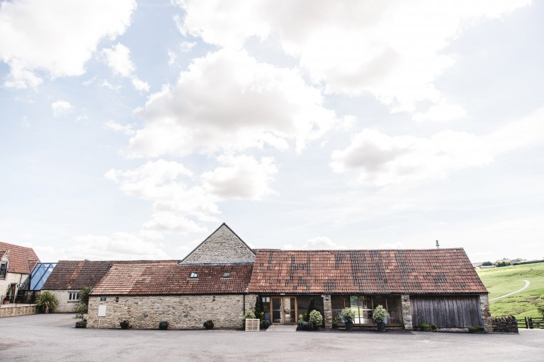 Front wide view of Kingscote barn wedding venue