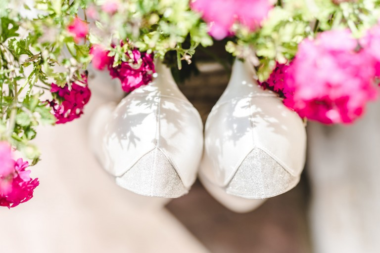 Wedding shoes hanging on a plant pot