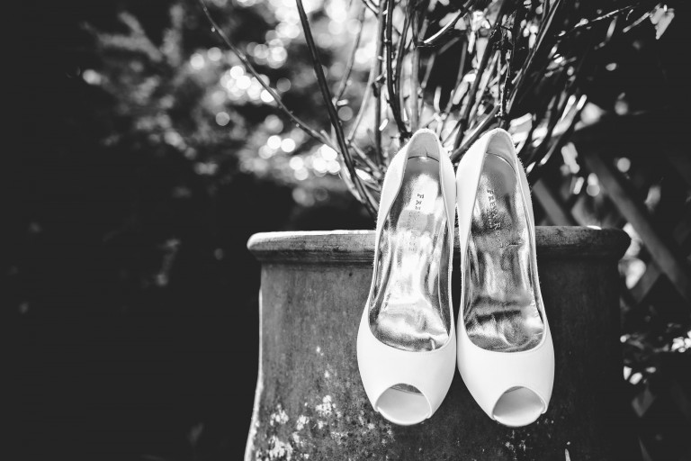 Wedding shoes hanging from a tree