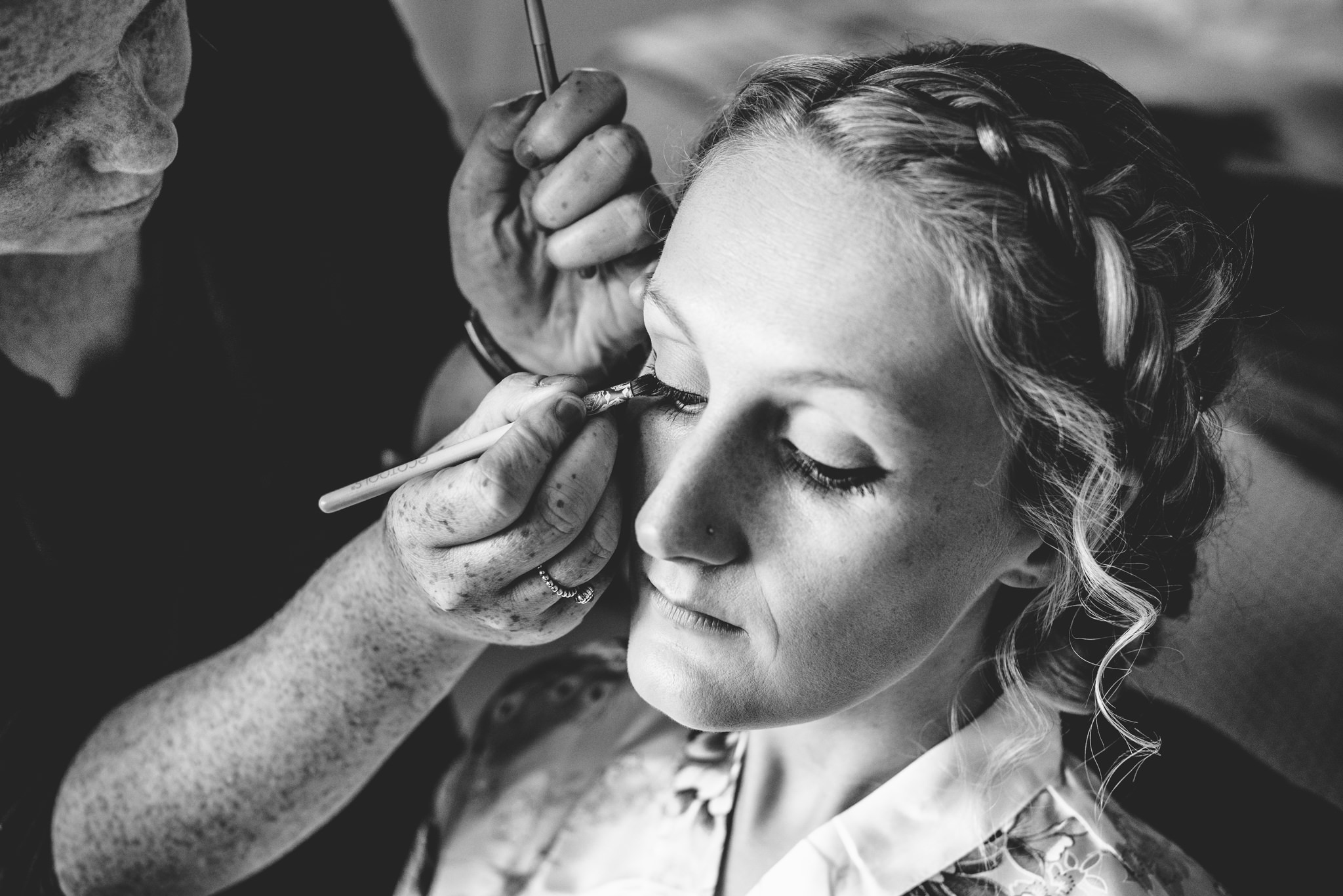 Bride having make up applied at Oxleaze Barn