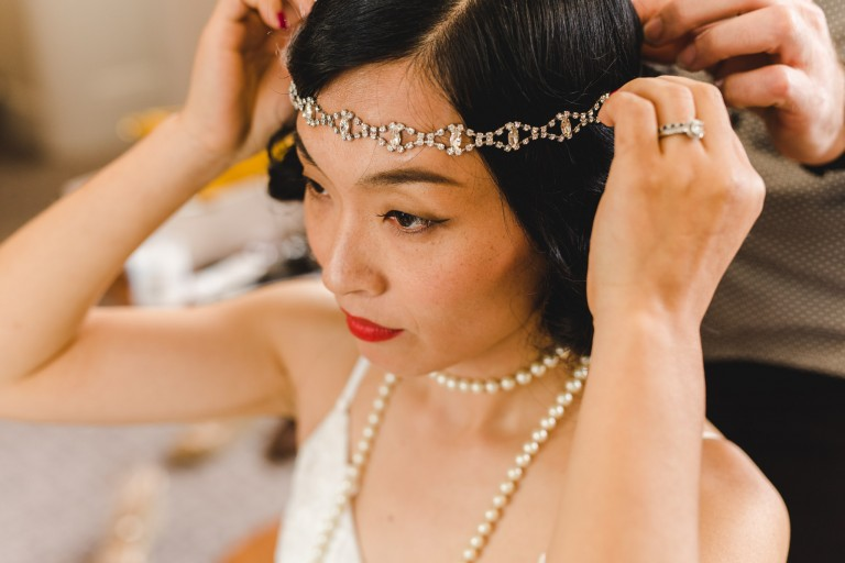 Chinese bride putting on her tiara