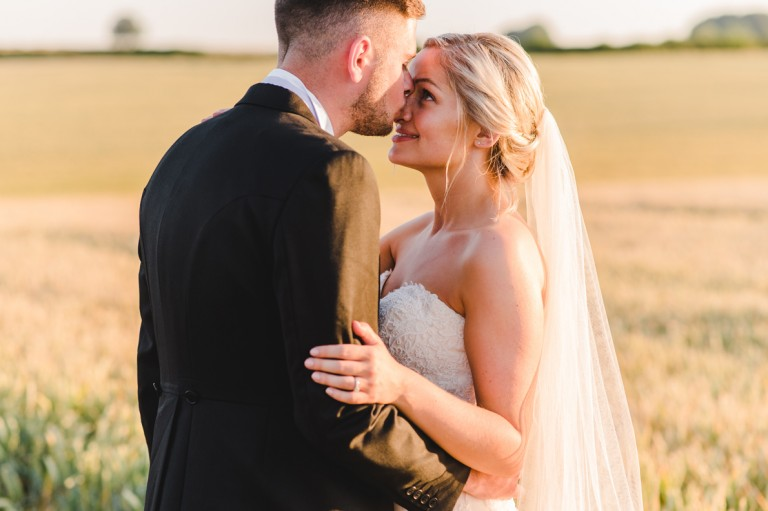 A kiss on the nose from a groom to a bride