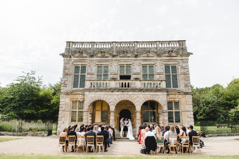 An outdoor wedding ceremony at the front of lodge park