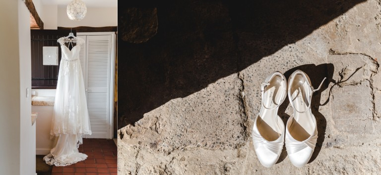 A brides dress and shoes hanging up in the cottages at GTB