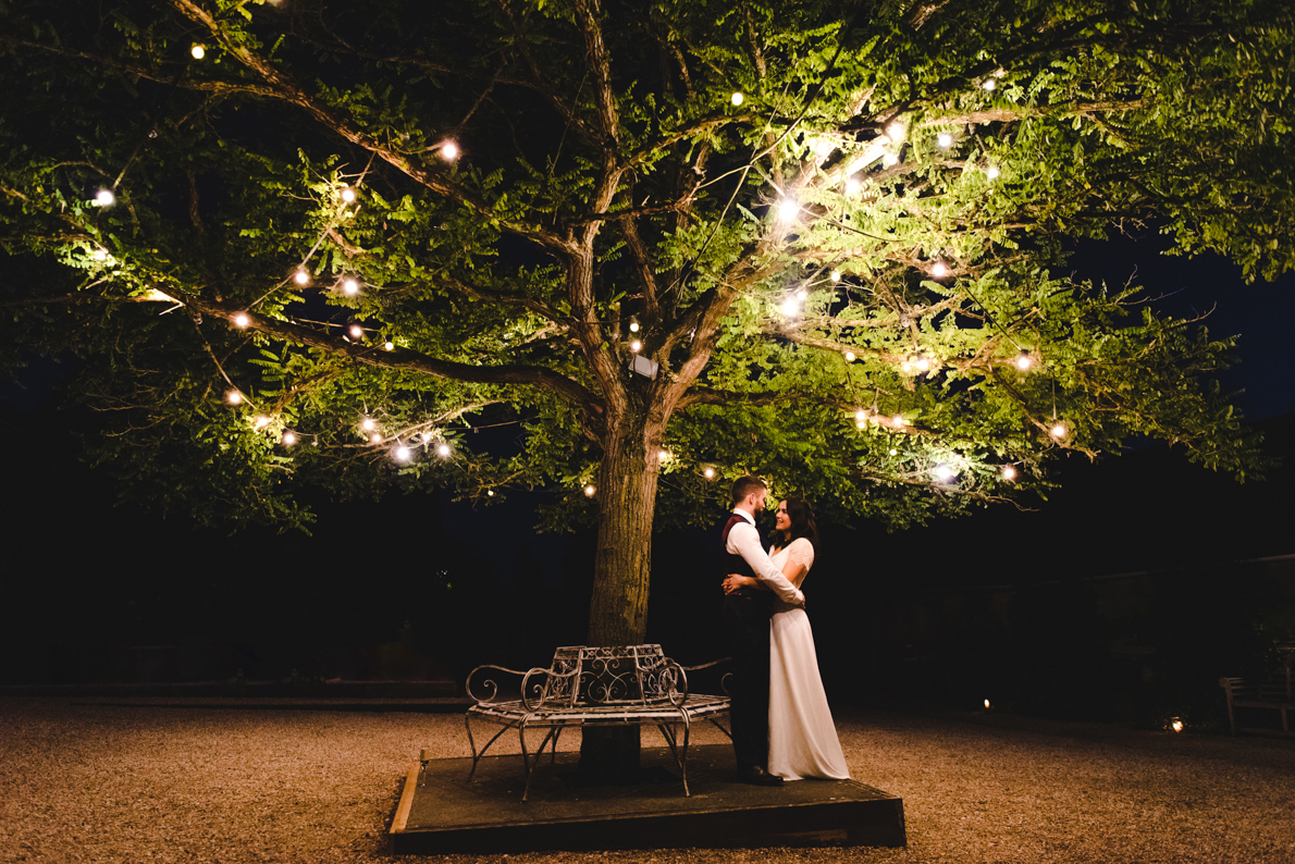 A couple under the fairy lights at Merriscourt - a Cotswold wedding venue