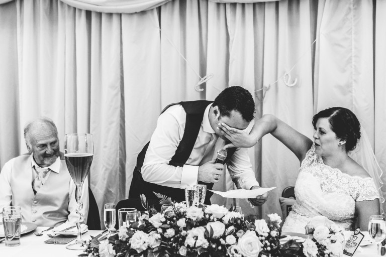 A bride wiping a tear from her groom at their Birtsmorton Court wedding day