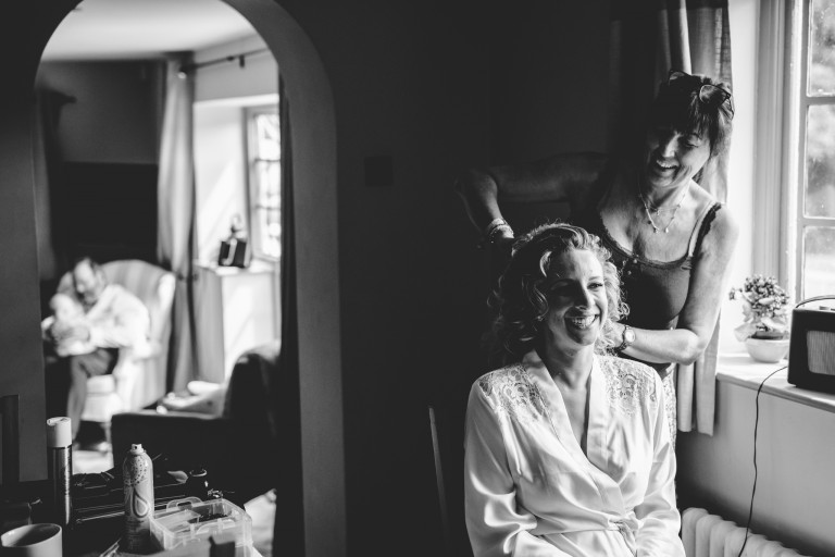 Black and white image of the bride getting ready for her wedding