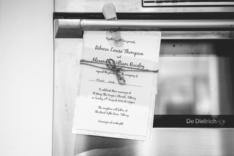 Wedding invitation stuck to a fridge