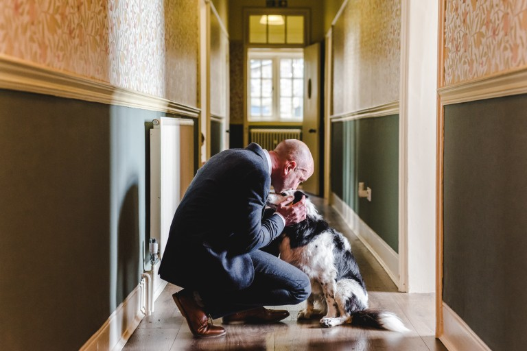 A man with his dog at a wedding