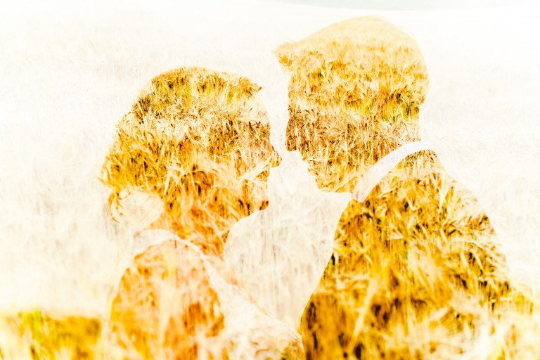 A double exposure of a couple in a cornfield
