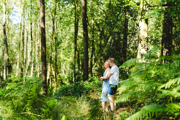 A couple on their engagement shoot on Leith Hill