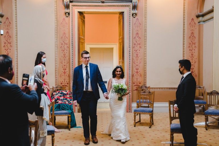 A bristol bride and groom walking down the aisle together